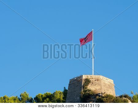 Unfurled Albanian Flag With Black Double-headed Eagle On A Red Background, Flying At Berati Castle.