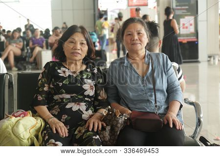 Noi Bai Airport, Ha Noi, Viet Nam - May 19,2017: Two Old Women Are Sitting On The Bench With Happy F