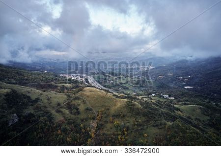 Autumn Alpine Speed Road In Italia. Aerial View From Above With Clouds On The Background And Village