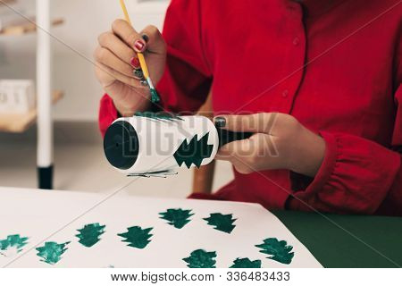 Woman Painting On Her Chirstmas Tree Paper. Xmas Concept