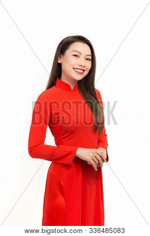 Portrait Of Young Asian Woman Wearing A Red Ao Dai With White Background.
