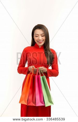 Asian Women Wearing Traditional Ao Dai Clothes Holding Shopping Bags