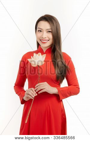 Vietnamese Girl Holding A Lotus Flower, The Ao Dai ( Long-dress Vietnamese) Is Traditional Costume O