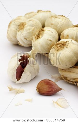 Garlic Braid Or Plait Closeup On A White Background