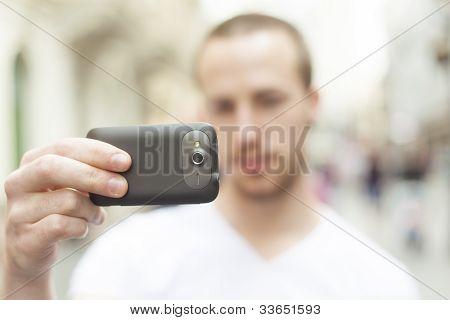 Urban Photographer With Mobila Phone Take Photo On Street
