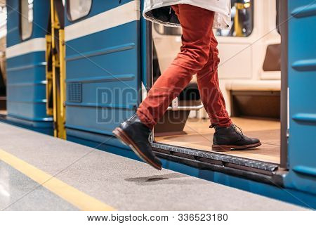 Handsome Man In Black Shoes, Burgundy Pants And White Jacket Runs Into A Subway Train. Male Is Late