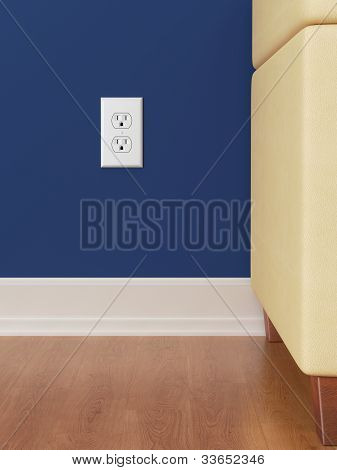 Power outlet on blue wall