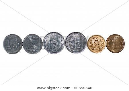 Closeup Indian currency Coins row isolated on white copy space