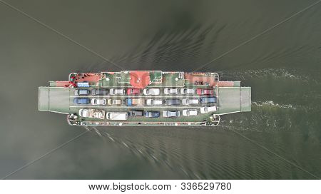 Top Down View Of Ferryboat Sailing. Ferryboat Transferring Cars. Ferry Transfers Cars And Passengers