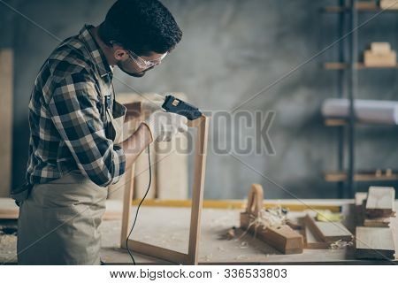 Profile Side Photo Of Serious Concentrated Worker Man Use Electric Hot Glue Gun To Repair Wooden Con