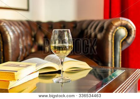 English Retro Style Room With Leather Chair, Open Book And Glas Of White Wine