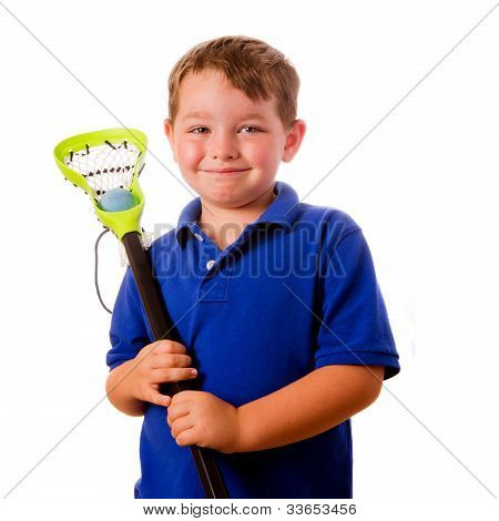 Child lacrosse player with his stick and ball isolated on white