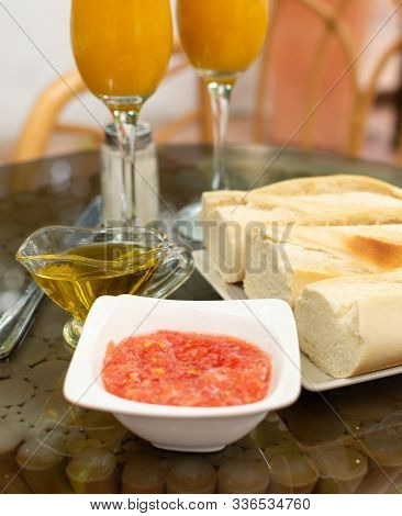 Traditional Andalusian Breakfast With Freshly Squeezed Orange Juice, Bread Toasts, Fresh Ground Toma