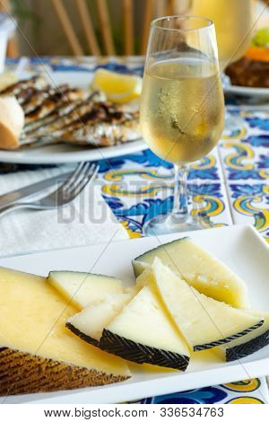 Andalusian Food, Chees En Espeto, Malaga Style Fish On Stick Barbecue Served With Dry Fino Sherry Wi