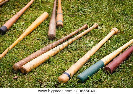 Vintage Baseball Bats Scattered On The Ground