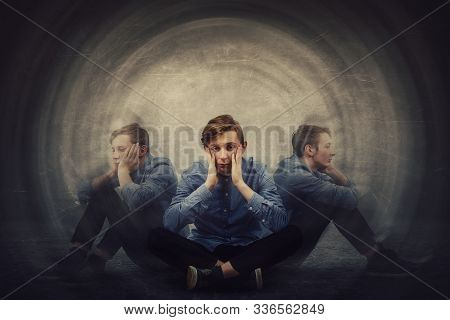 Teenage Guy Seated On The Floor Suffer Split Emotions Into Three Different Inner Personalities. Mult