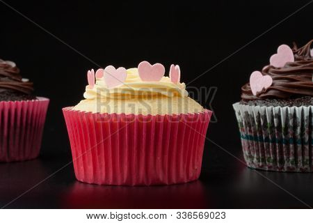 Vanilla Cupcake With Hearts On Icing Black Background