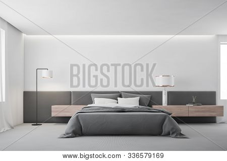 White Master Bedroom Interior With Lamp