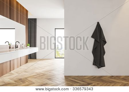 Side View Of White And Wooden Bathroom With Sink