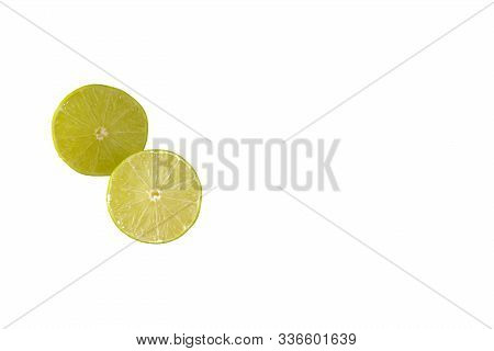 Two Lime Halves Isolated On A White Background With Copy Space