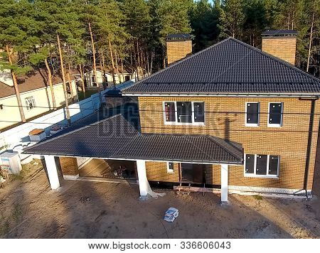 New Brick House. House With A Ceramic Tile Roof. Cement-sand Roof Tiles.