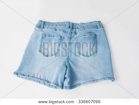 Back Of Blue Jean Shorts Isolated On A Light Background Flat Lay Summer Fashion.  Pockets Shown On T