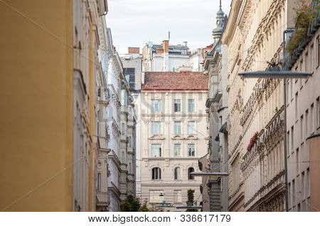 Typical Austro-hungarian Facades Wit Old Windows In A Narrow Street Of Innere Stadt, The Inner City