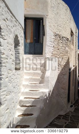 White Intuitively Built Staircase To Typical Greek Style House Entry