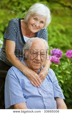 Happy senior couple in the garden