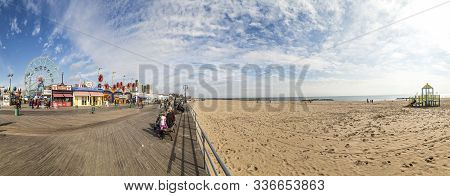 People Visit Famous Old Promenade At Coney Island, The Amusement Beach Zone Of New York