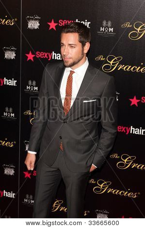 BEVERLY HILLS, CA - MAY 21: Zachary Levi arives at the Gracie Awards Gala on May 21, 2012 at the Beverly Hilton Hotel in Beverly Hills, California.
