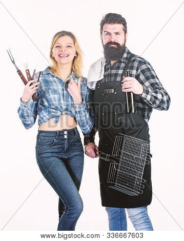 Perfect For A Summer Cookout. Couple Of Bearded Man And Pretty Woman Holding Bbq Set. Bbq Is A Cooki