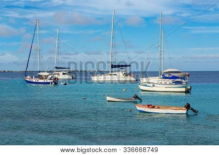 Group Of Sailing Boats Floating On Blue Water Near Coast Of Bonaire