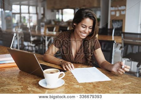 Business, Gig Economy Concept, Charming Young Brazilian Female Entrepreneur Sitting Co-working Cafe,