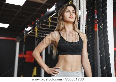 Lowe-angle Shot Assertive, Strong And Fit Healthy Female Athlete With Six-pack Abdominal Muscles, Ho
