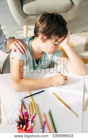Cropped View Of Child Psychologist Touching Sad Kid With Dyslexia