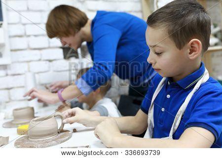 People Sculpt Clay Mugs
