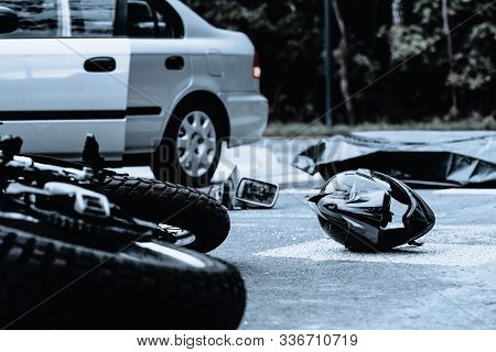 Motorcycle Helmet On The Street After Terrible Car Crash