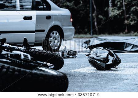 Motorcycle Helmet On The Street After Terrible Car Crash