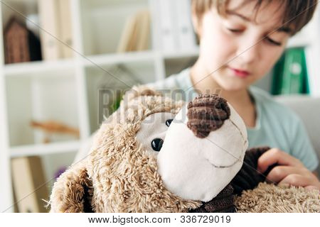 Selective Focus Of Kid With Dyslexia Holding Teddy Bear