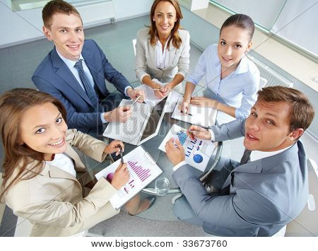 Image of large group of confident partners looking at camera