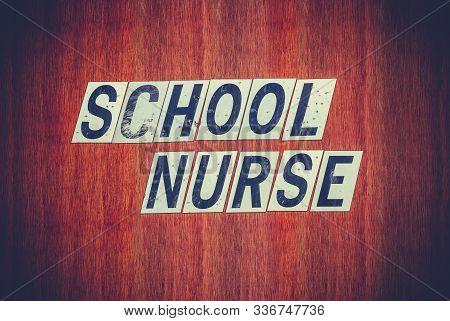 A Grungy Sign For A School Nurse In A Rundown Public School