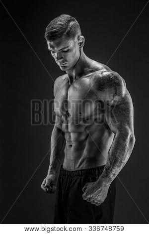 Very Brawny Guy Bodybuilder Posing. Beautiful Sporty Guy Male Power. Fitness Muscled Man In Studio.
