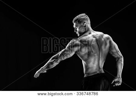 Very Brawny Guy Bodybuilder Posing. Beautiful Sporty Guy Male Power. Fitness Muscled Man Showing His