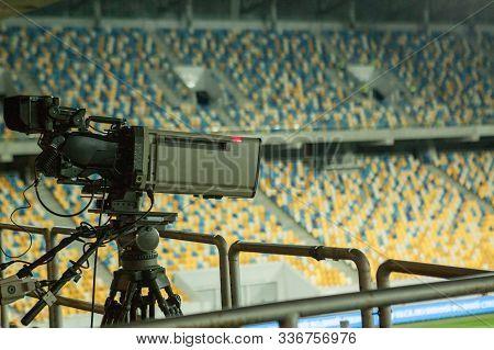 Lviv, Ukraine-august19, 2019: Tv Camera Man Shooting Live A Professional Soccer Match, At The Footba