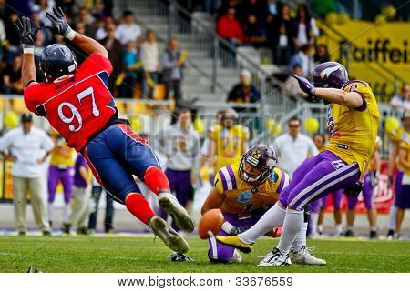 VIENNA, AUSTRIA - MAY 8 Kicker Peter Kramberger (#2 Vikings) kicks a PAT on May 8, 2011 in Vienna, Austria. The Vienna Vikings beat the Calanda Broncos 15:12.