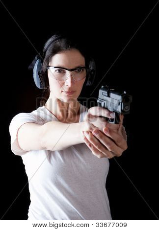 Woman aiming a gun with protective gear poster