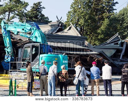 Aso, Japan - November 5, 2016: Debris Being Cleared In Heavily Damaged Aso Shrine After 2016 Kumamot