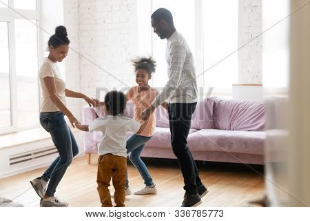 Happy African American Family With Kids Dance Together At Home