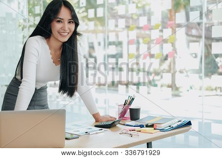 Asian Executive Businesswoman Woman Smiling At Business Workplace